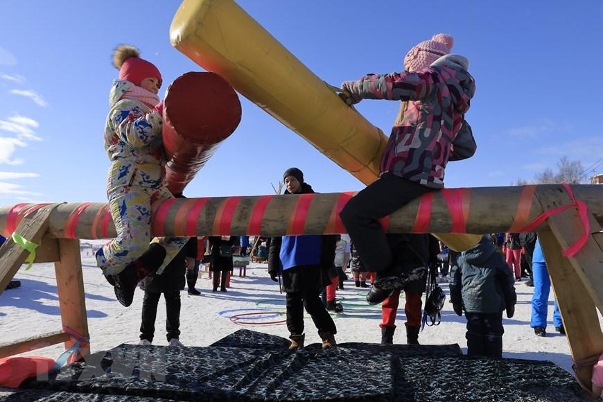 Rực rỡ sắc màu lễ hội người chăn hươu phương Bắc Nga - Ảnh 2.