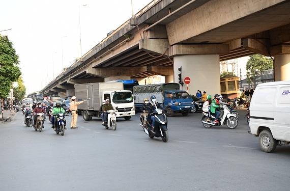 Bộ Công an kiến nghị bắt buộc môtô, xe gắn máy định kỳ kiểm tra khí thải - Ảnh 1.
