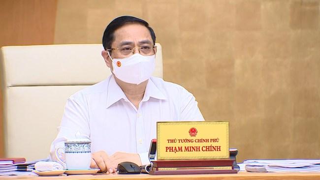 Thủ tướng Chính phủ: Tháo gỡ kịp thời vướng mắc trong nghiên cứu, sản xuất vaccine phòng COVID-19 - Ảnh 1.
