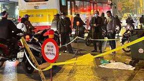 Phát hiện thai nhi trong túi đen cạnh thùng rác bị ô tô cán qua ở Hà Nội