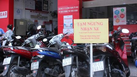 TP.HCM: Dịch vụ sửa xe máy tấp nập trong hai ngày cuối tuần